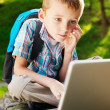 Boy with notebook in the park — Stock Photo