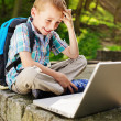 Boy delighted with notebook — Stock Photo