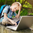 Stock Photo: Smiling boy with laptop.