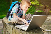Boy delighted with laptop — Stock Photo