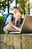 Lucky boy with laptop — Stock Photo