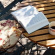 Book and coffee on wood table — Stock Photo