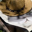 Book and straw hat on deckchair — Stock Photo