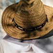 Book and straw hat on deckchair — Stock Photo #11447966