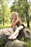 Girl sitting on the stone — Stock Photo