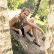 Girl sitting on the stone — Stock Photo
