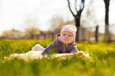 Baby lie on grass — Stock Photo