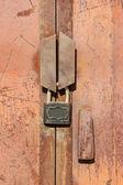Rusty lock on garage gate — Stock Photo