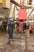 Worker in rig floor — Stock Photo