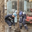 Two drillers at work - Stock Photo