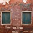 Stock Photo: Two old windows with shutters