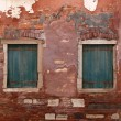Two old windows with shutters — Stock Photo