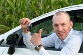 Smiling man sitting in the car — Stock Photo
