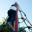 Stock Photo: Child climbs up