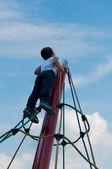Child climbs up — Stock Photo