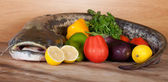 Big catfish with vegetables — Stock Photo