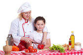 Mother and daughter cooking dinner — Стоковое фото