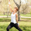 Sport exercises in the park — Stock Photo