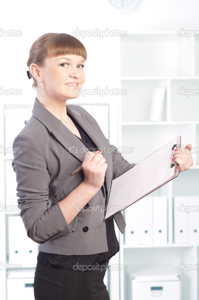 Portrait of a beautiful young woman who works in the office  Stock Photo #10894893