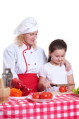 Mother and daughter cooking dinner — Stok fotoğraf