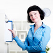 Woman puts a tablet with documents in a Shelfs — Stock Photo #11022999