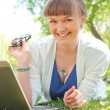 Stock Photo: Portrait of womwithlaptop