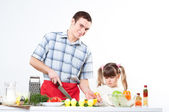 Father and daughter cook together — Stock Photo