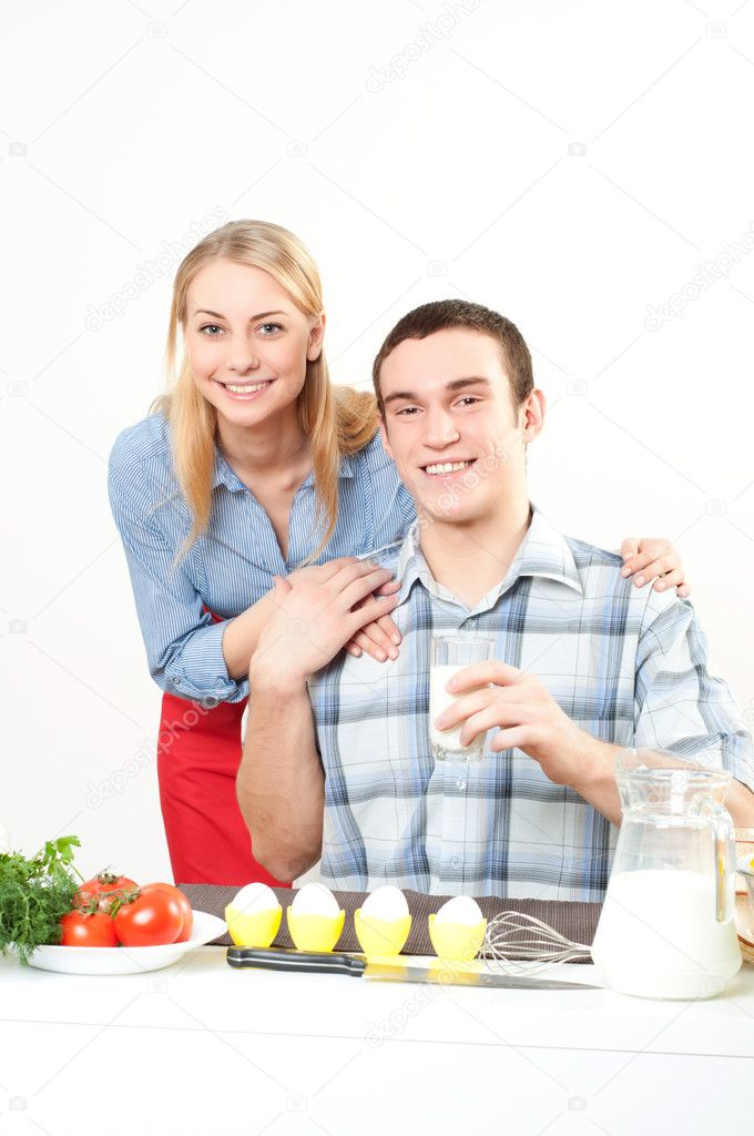 Wife embraces the husband, he holds a glass of milk — Stock Photo #11224796
