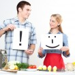 Couple holding a plate with signs — Stock Photo