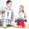 Stock Photo: Couple holding a plate with signs