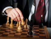 Businessman plays chess — Stock Photo