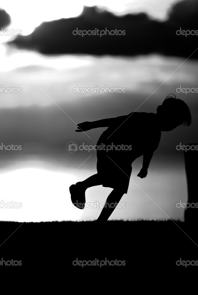 Silhouette of a boy  on sunset background in black and white. — Stock Photo #11104728