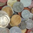 Stock Photo: 5 rupee coins stacked on indicoins background