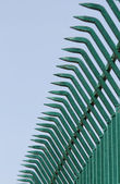 Pointed wrought iron bars forged to form a fence — Stock Photo