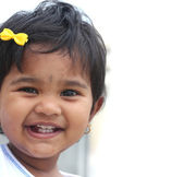 Photo of pretty and happy indian baby girl with expressive eyes — Stock Photo
