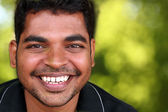 Photo of happy lively handsome middle-aged Indian/asian youth la — Stock Photo