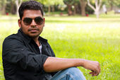 Photo of an handsome, stylish, casual and young indian/south ind — Stock Photo