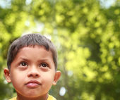 Young indian boy of kinder-garten school age thinking or dreamin — Stock Photo