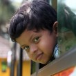Handsome and cute little indian school kid looking back with hap — Stock Photo