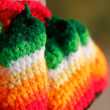 Beautiful multicolored handwoven woolen dress closeup photo. The — Stock Photo