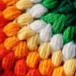 Beautiful colorful handmade woolen fabric closeup photo. The col — Stock Photo
