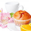 Two muffins, orange and flowers - Photo