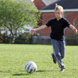 Teenage boy playing football — Stock Photo