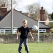 Stock Photo: Teenage boy playing football