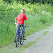 Teenage boy riding a bike — Stock Photo