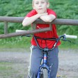 Teenage boy in the park with his bike — Stock Photo