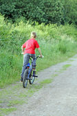 Teenage boy riding a bike — Stock Photo