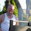 Man cooking at the bbq — Stock Photo