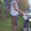 Stock Photo: man cooking at the bbq
