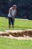 Man playing golf — Stock Photo